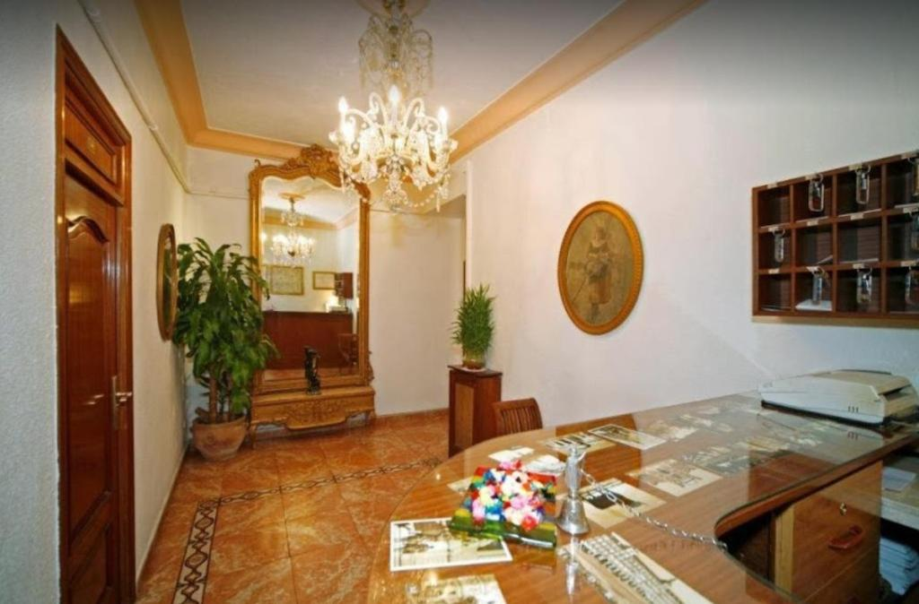 El vestíbulo o zona de recepción de Hostal Prada