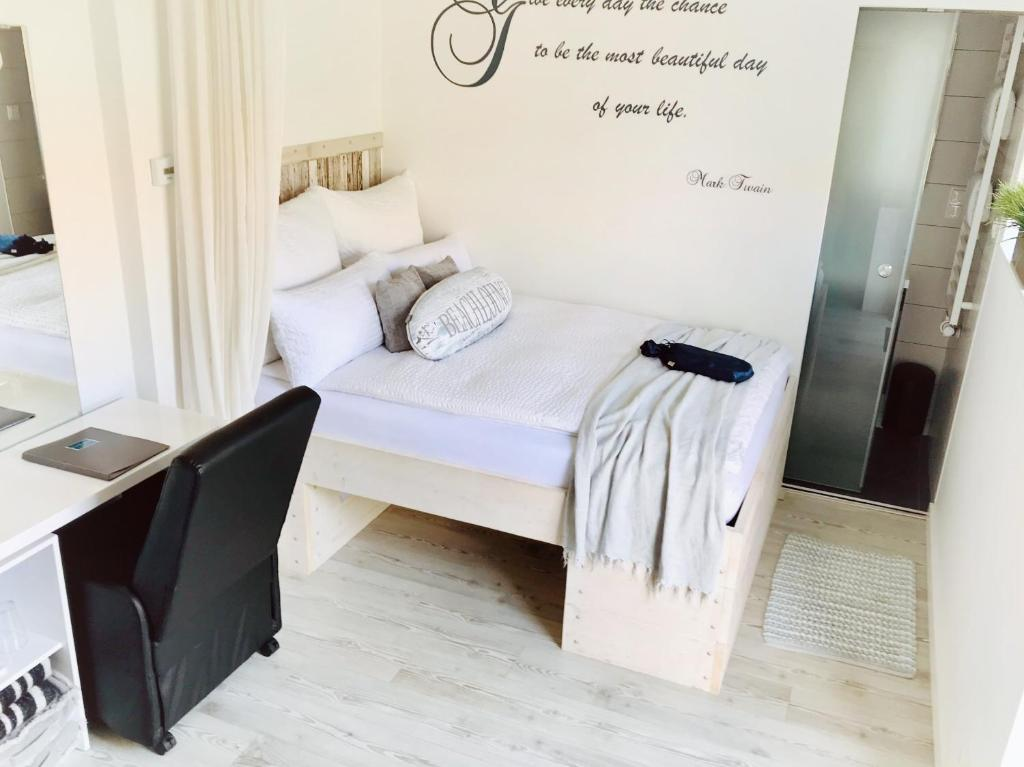 A bed or beds in a room at BeachLounge Zandvoort