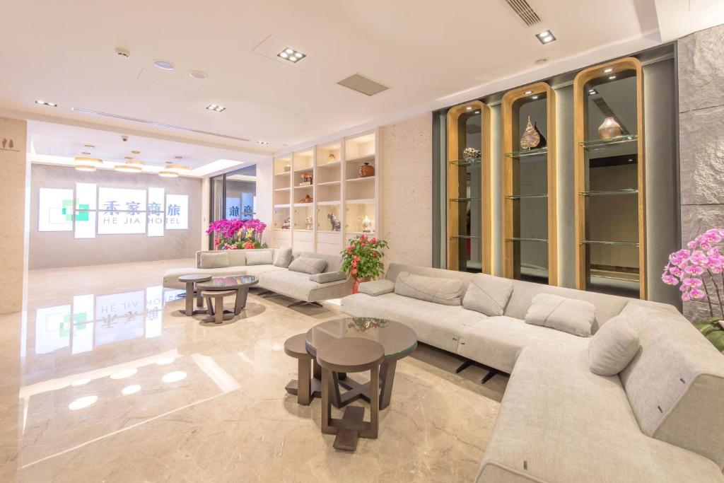 The lobby or reception area at He-Jia Hotel