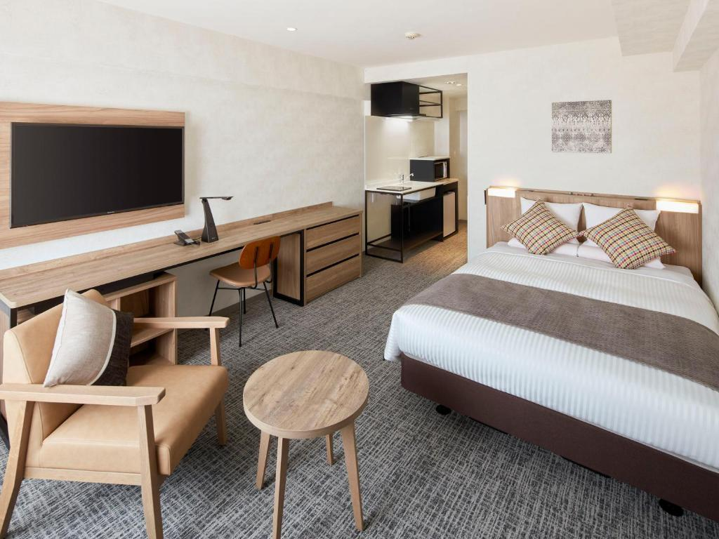 Tempat tidur dalam kamar di HOTEL MYSTAYS Kiyosumi shirakawa