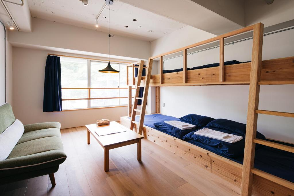 A bunk bed or bunk beds in a room at Uzu House