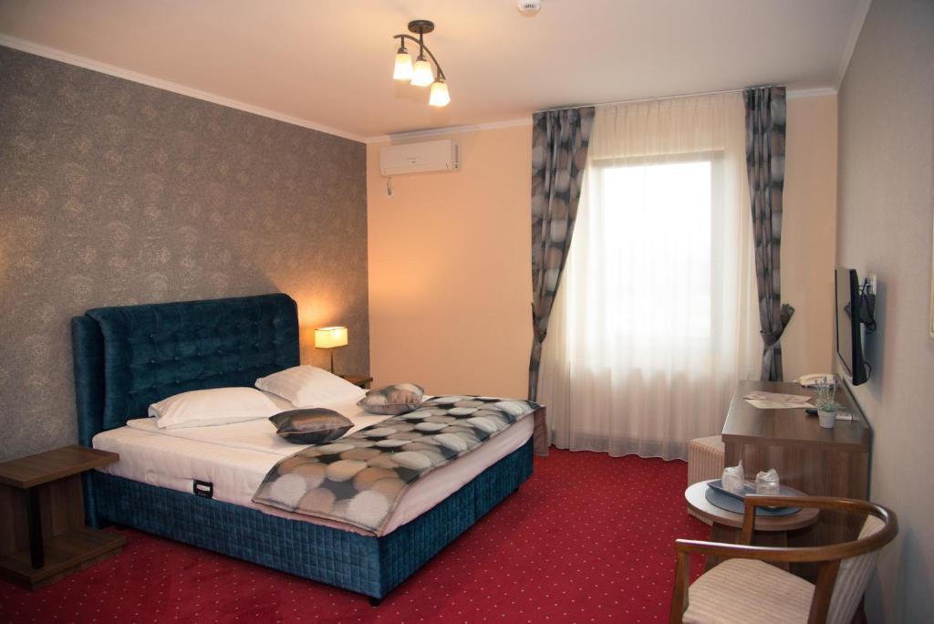 Un pat sau paturi într-o cameră la Hotel Stefani