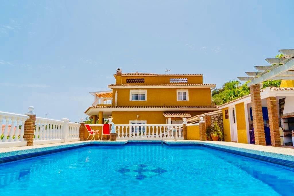 The swimming pool at or near Villa El Cerrillo
