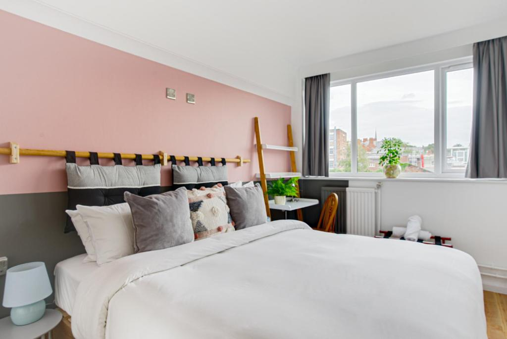 A bed or beds in a room at Selina Liverpool
