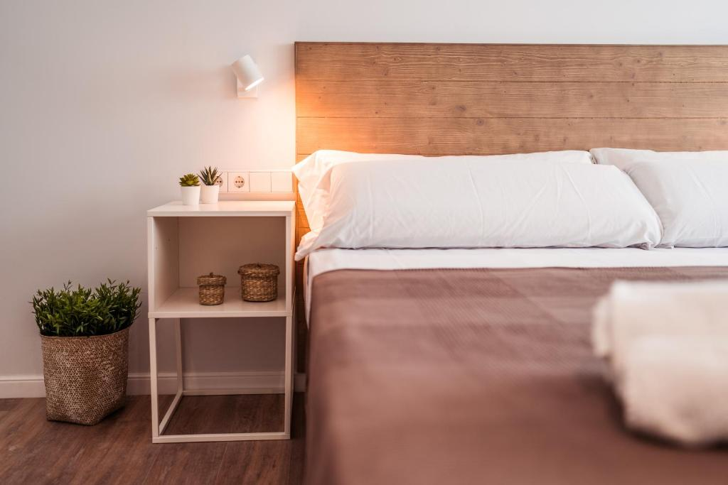 A bed or beds in a room at Lindala