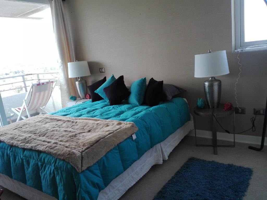 A bed or beds in a room at Departamento por días-semanas para empresas