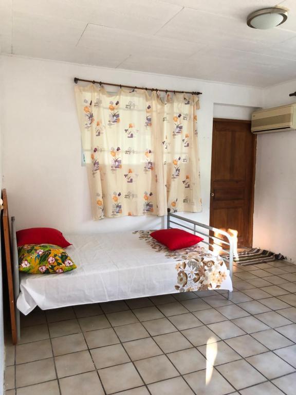 Cama ou camas em um quarto em Chez Will et Wendy MATAVAI