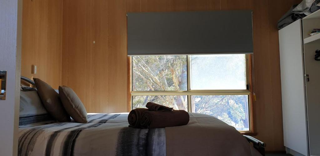 A bed or beds in a room at Mount Rumney Escapes