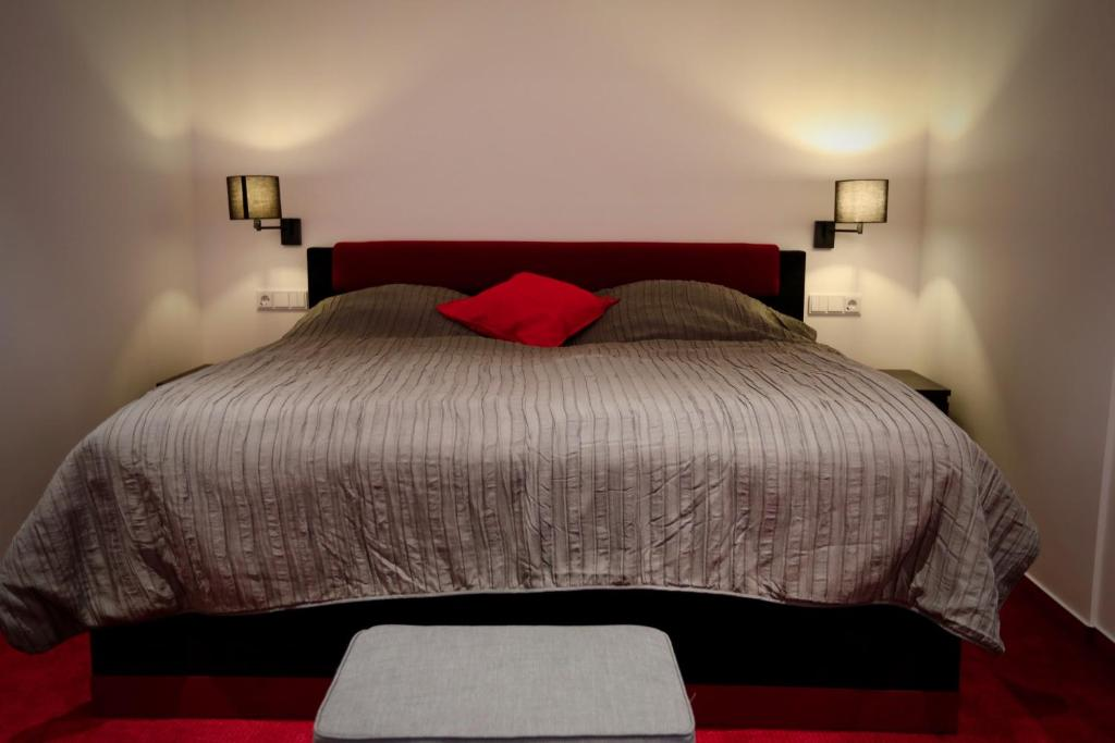 A bed or beds in a room at K&M Hostel
