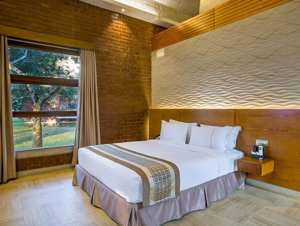 A bed or beds in a room at Sarah Resort