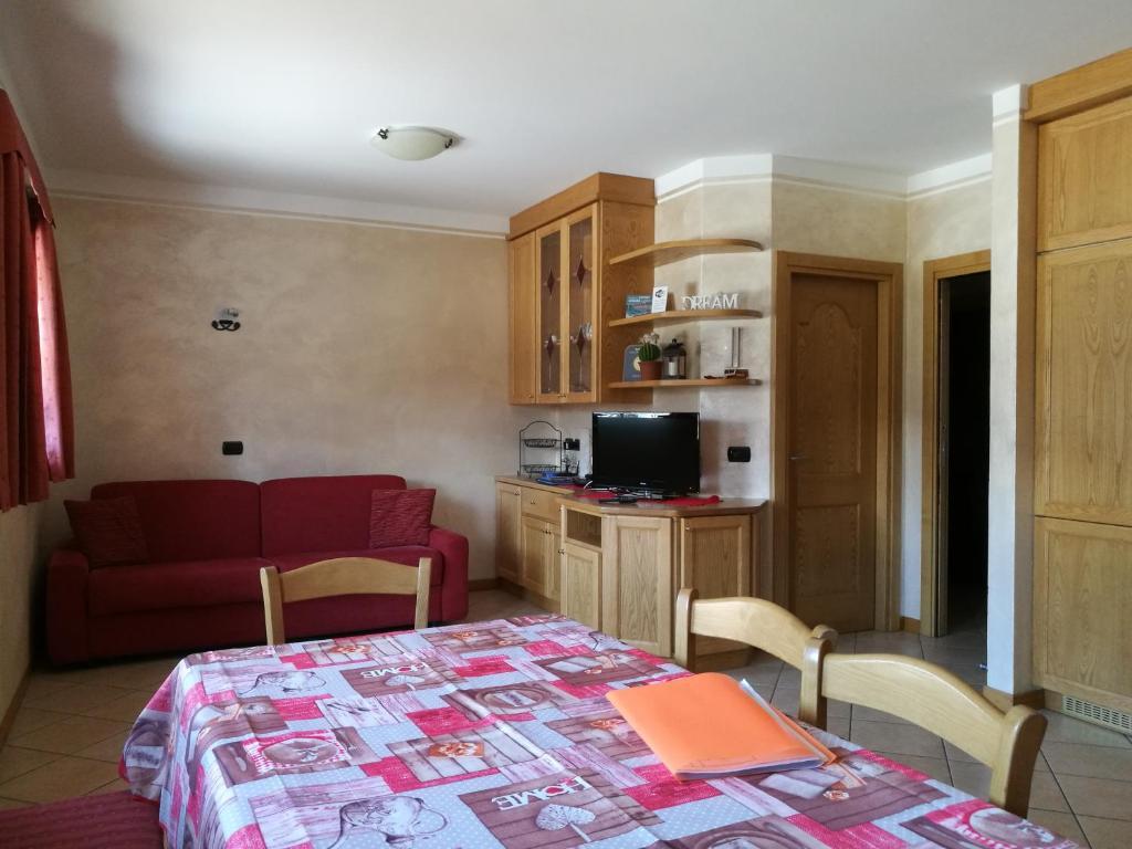 TV a/nebo společenská místnost v ubytování Chalet Claudia