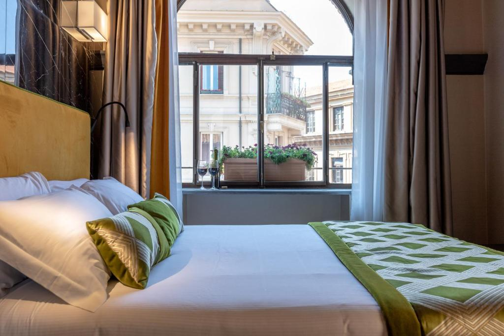 A bed or beds in a room at NEMAN Maison Experience I Pantheon