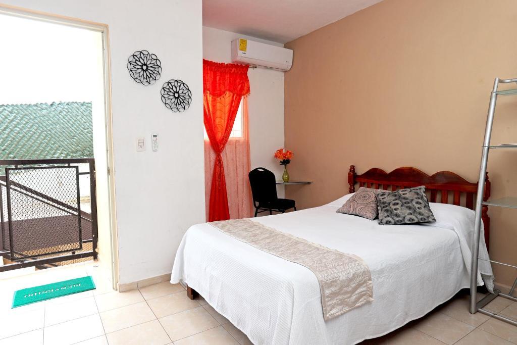 Ein Bett oder Betten in einem Zimmer der Unterkunft Casa de Ana