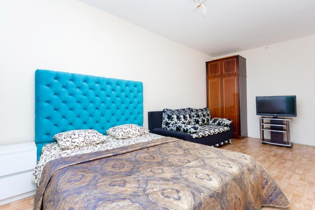 A bed or beds in a room at Apartment Zhukovskogo 5/2