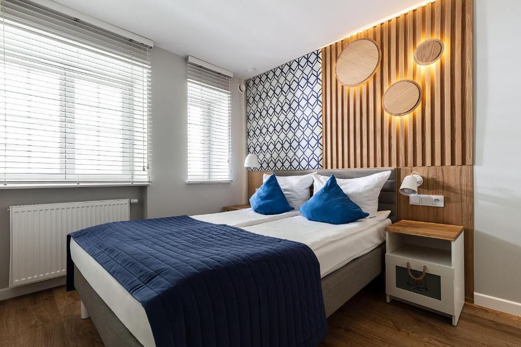 Кровать или кровати в номере Anchor House Sopot