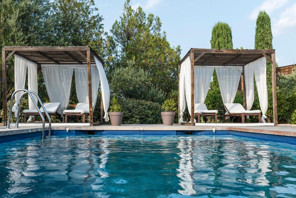The swimming pool at or near Guesthouse Le Mas de Cotignac