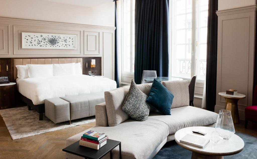 A bed or beds in a room at The Trafalgar St. James, London Curio collection by Hilton