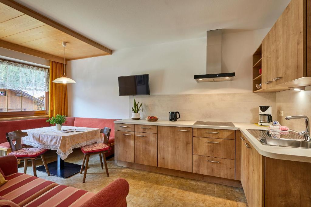 A kitchen or kitchenette at BelaVal Apartments - Calfosch