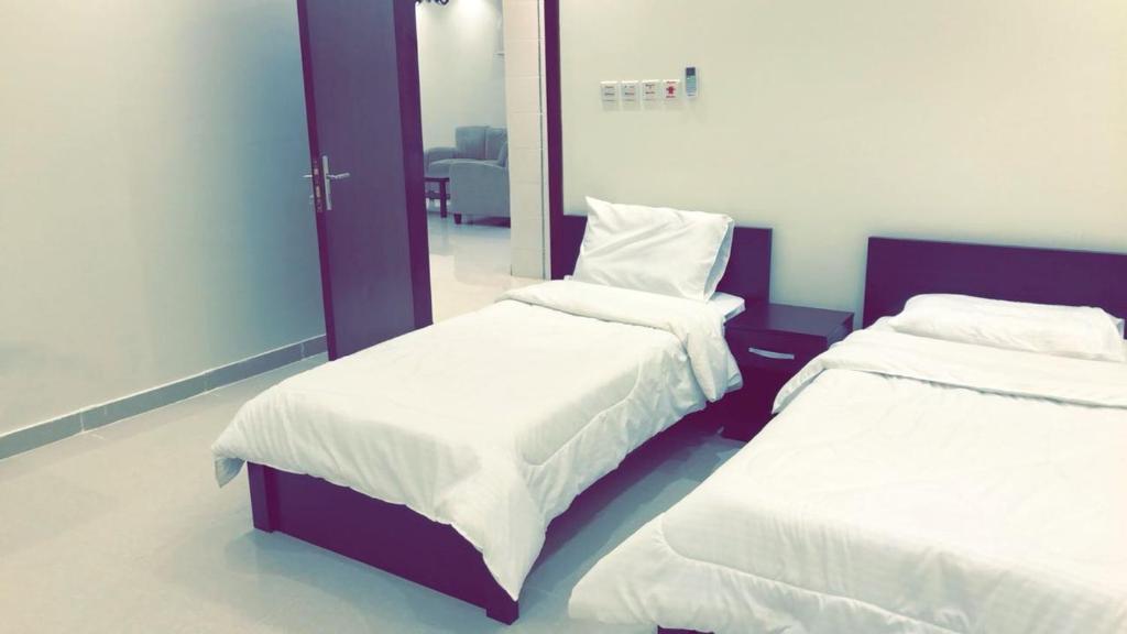 Cama ou camas em um quarto em Al Taif Villas