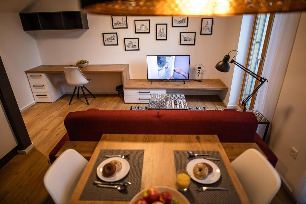 A television and/or entertainment center at Postcard City Apartments