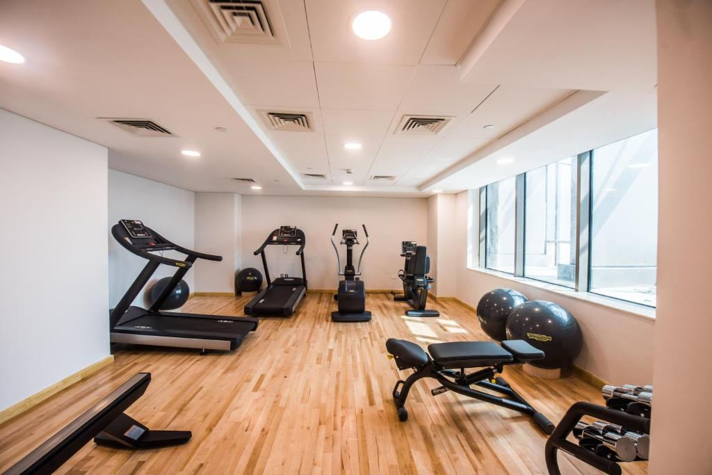 The fitness center and/or fitness facilities at Fantastay Sparkle Tower One Bedroom Suite Marina view