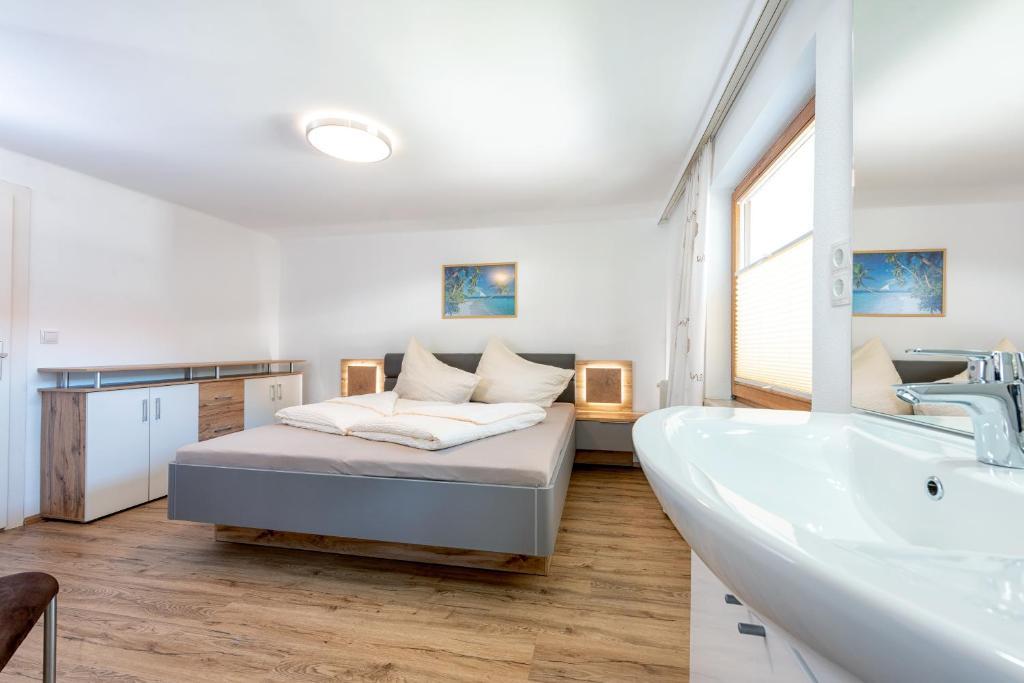 Кровать или кровати в номере AlpenLiving