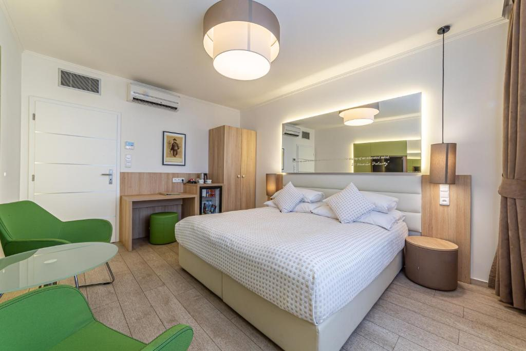 A bed or beds in a room at Salvator Boutique Hotel