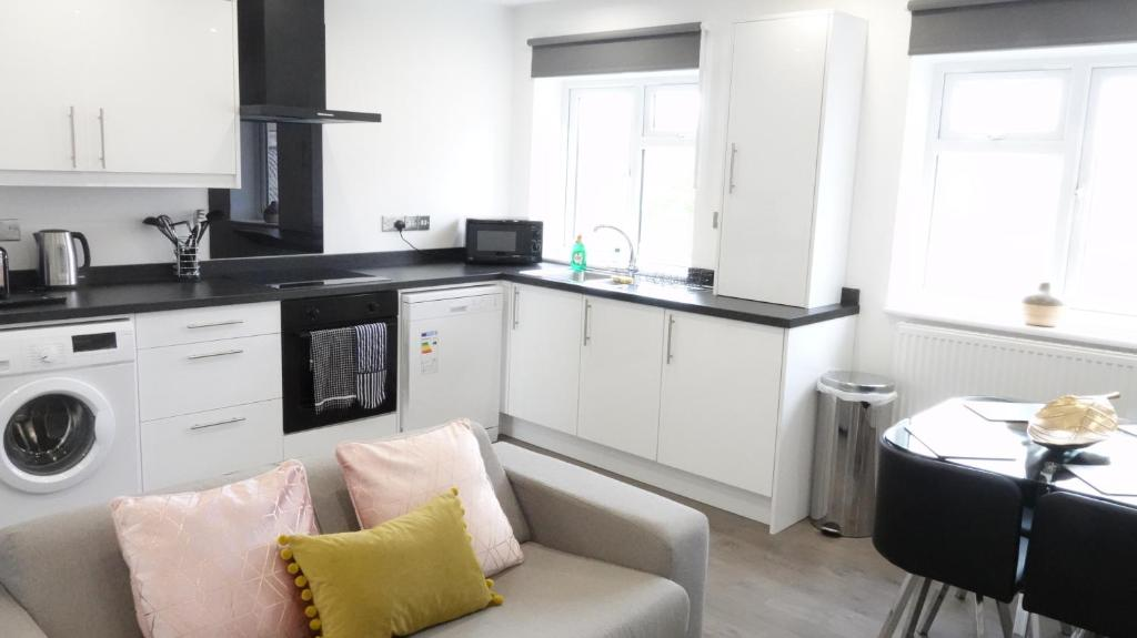 A kitchen or kitchenette at The Hatton Apartments - Free Parking