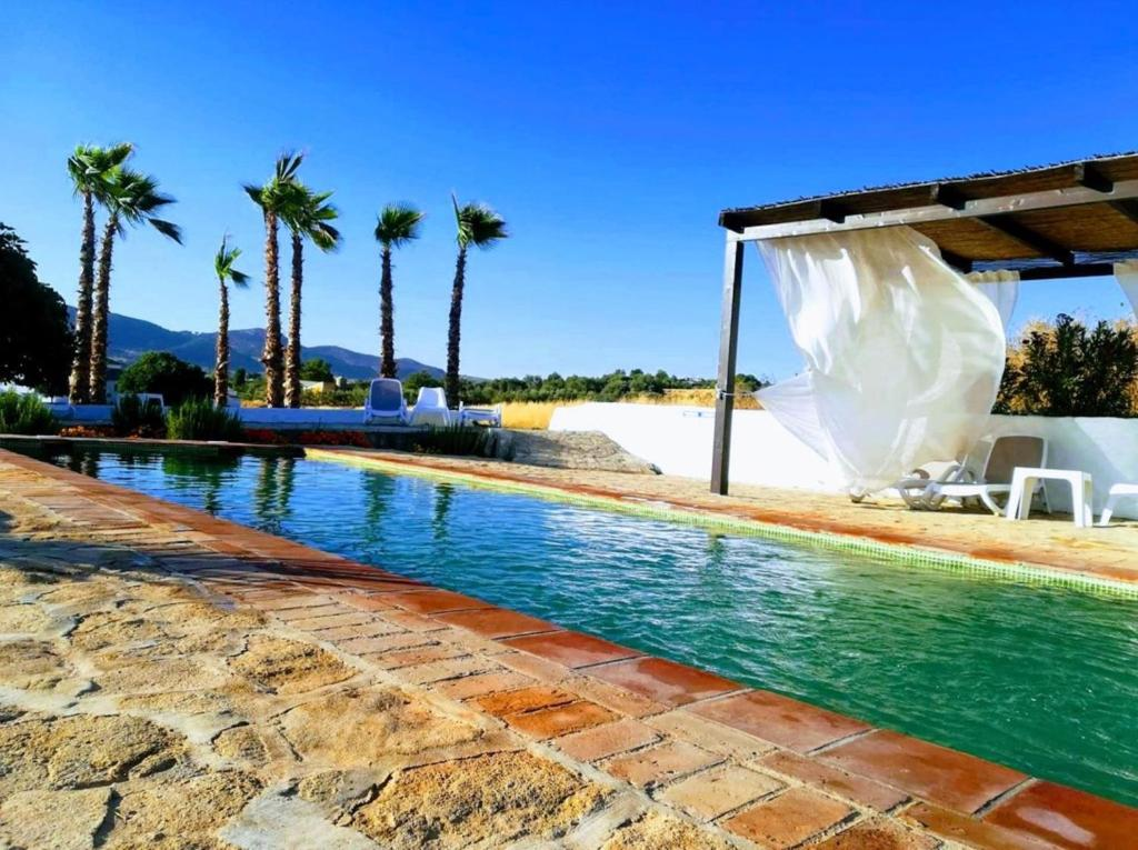 The swimming pool at or near Hotel Ronda Moments