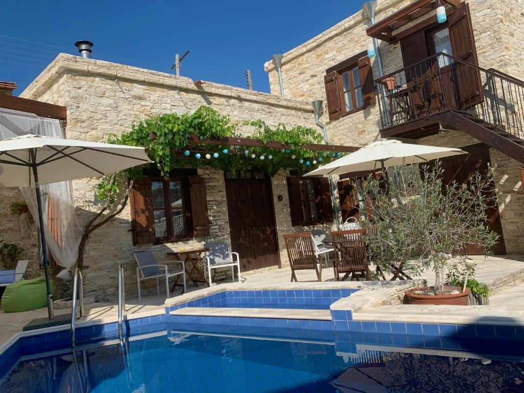 The swimming pool at or near Palatakia - Adults Only