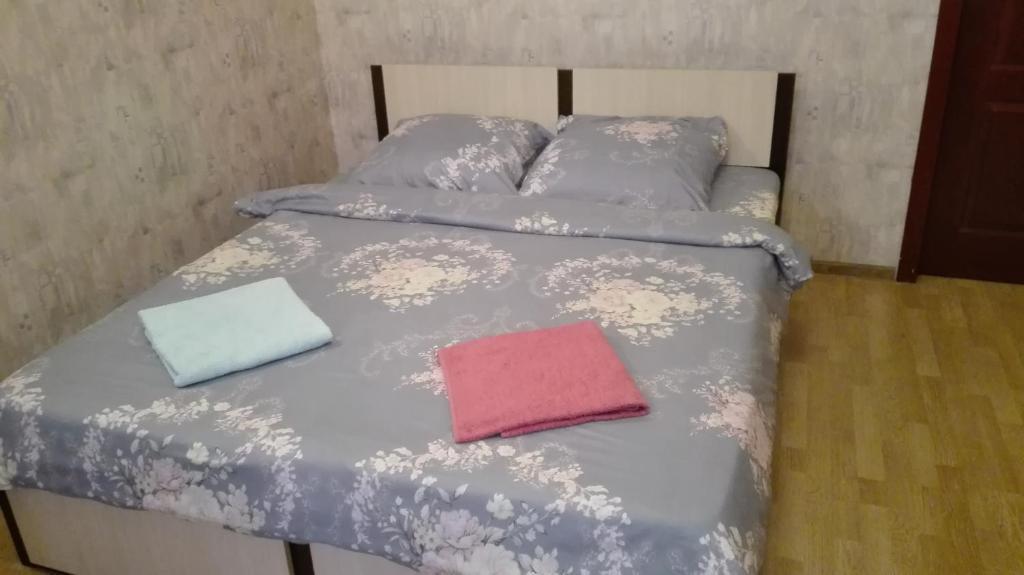 Кровать или кровати в номере Apartment Mitino Park