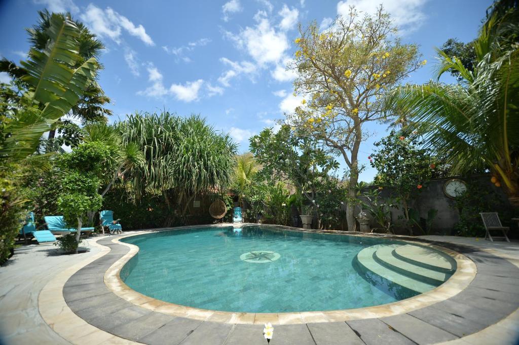 The swimming pool at or near Hibiscus House Pemuteran Bali