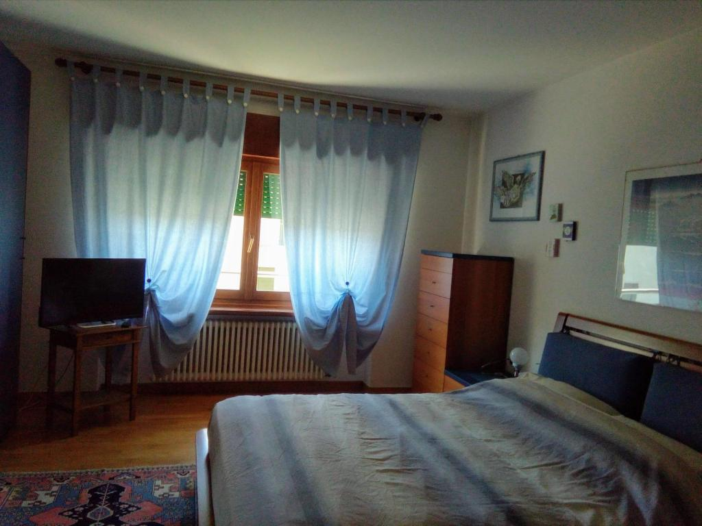 A bed or beds in a room at B&B Da Bona