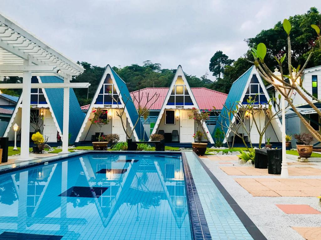 The swimming pool at or near Nipah Guesthouse Pangkor