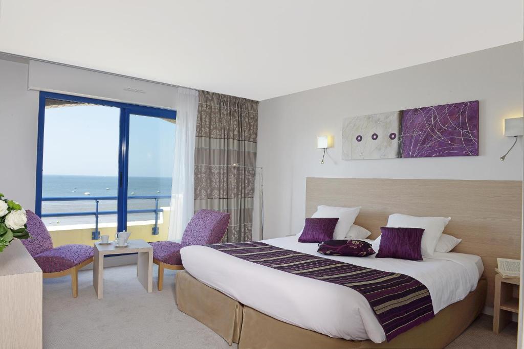 Un ou plusieurs lits dans un hébergement de l'établissement Hôtel De La Plage