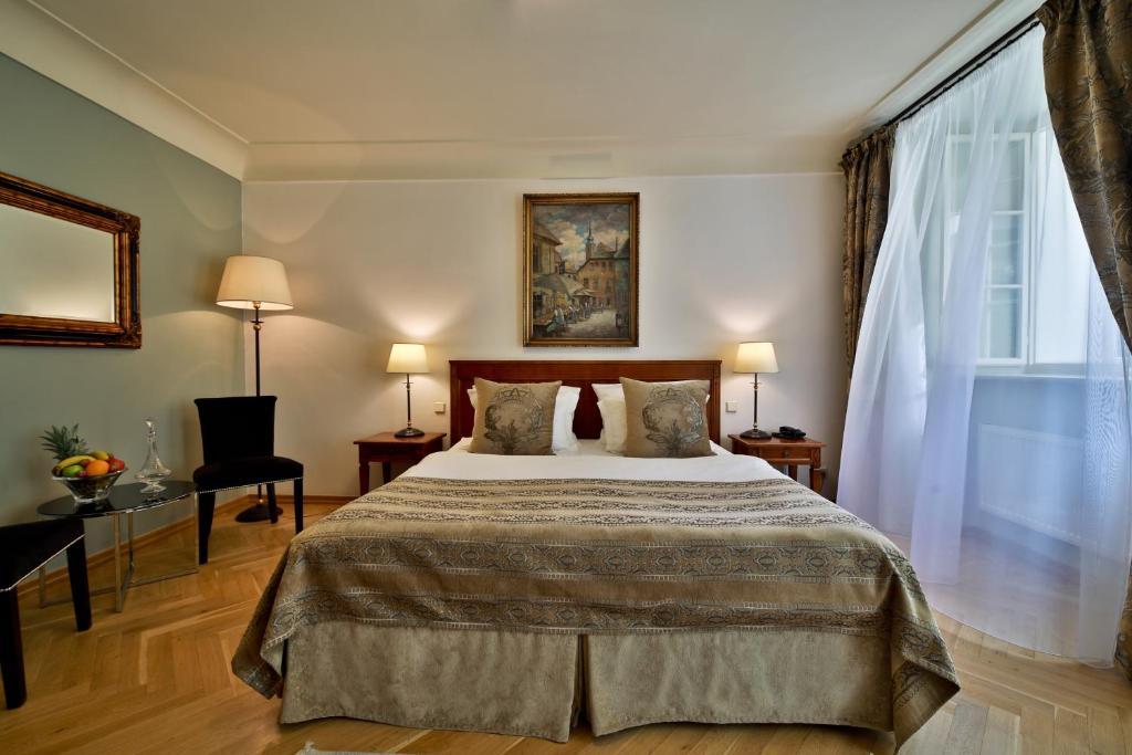 Letto o letti in una camera di Appia Hotel Residences