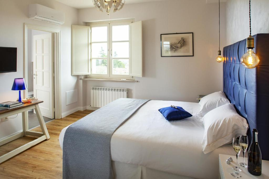 A bed or beds in a room at CorteViva Boutique B&B