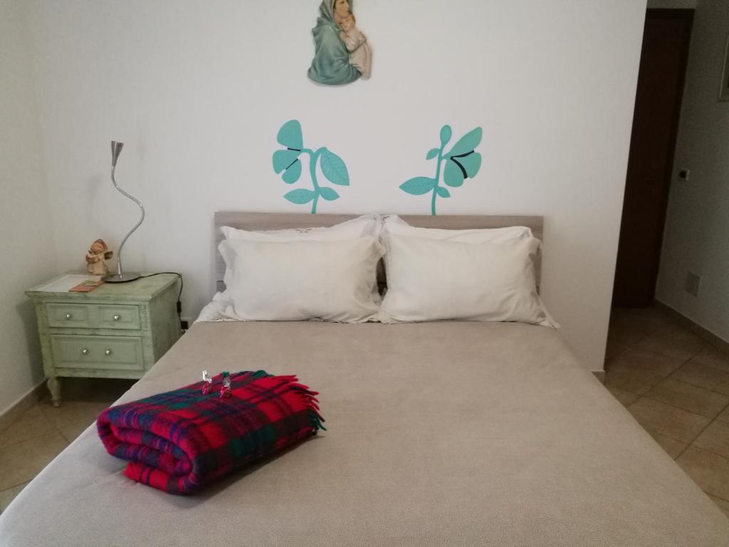 A bed or beds in a room at Fortuna Suites