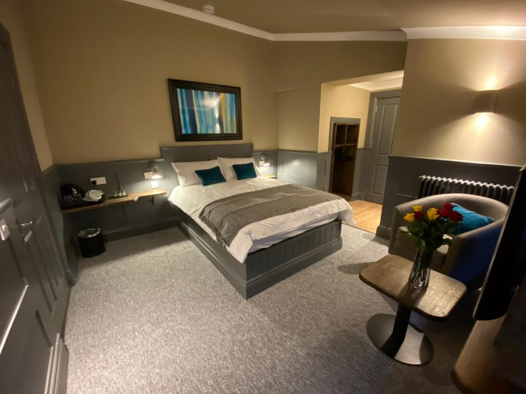 A bed or beds in a room at Irvine Guest House