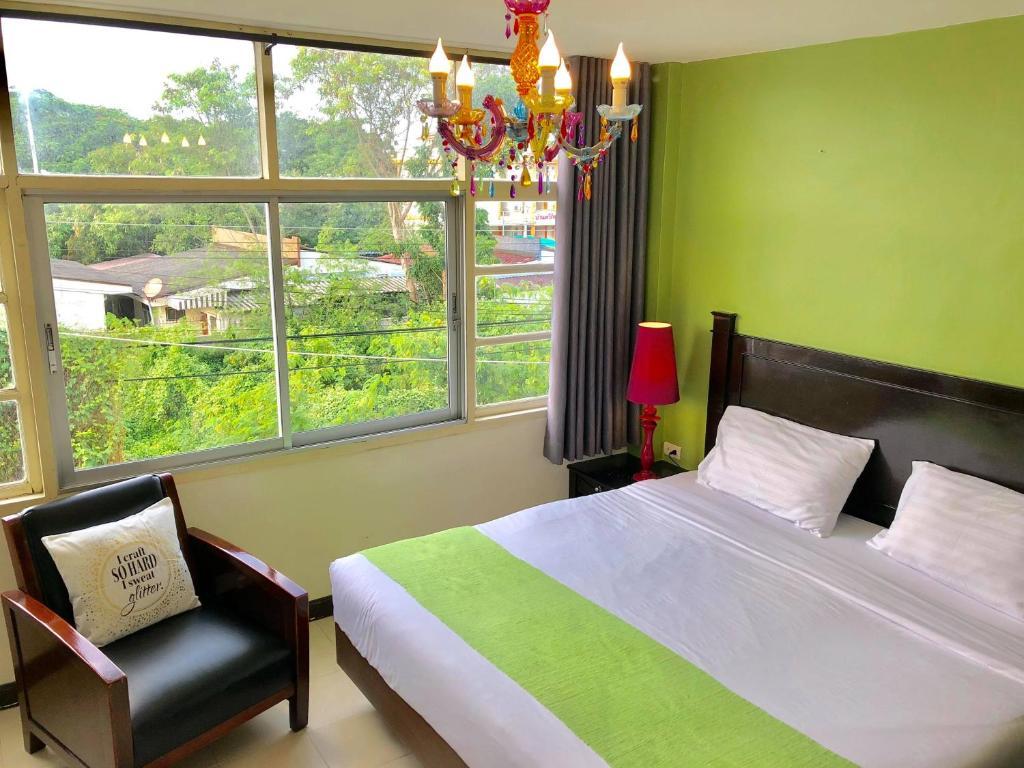 A bed or beds in a room at Baan Nilawan Hua Hin Hotel