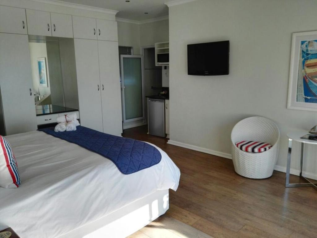A bed or beds in a room at Ahoy Boutique Guest House