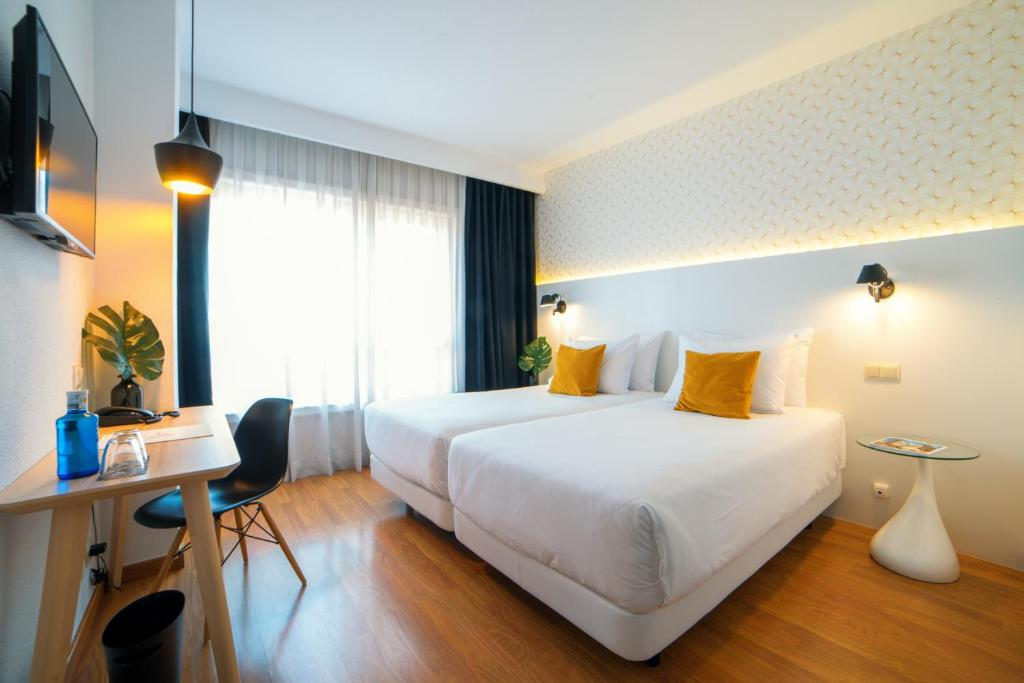 A bed or beds in a room at Hotel Cetina Murcia