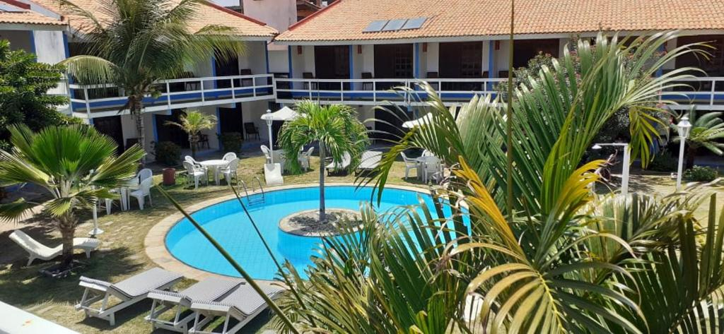 A view of the pool at Hotel Cumbuco Praia or nearby