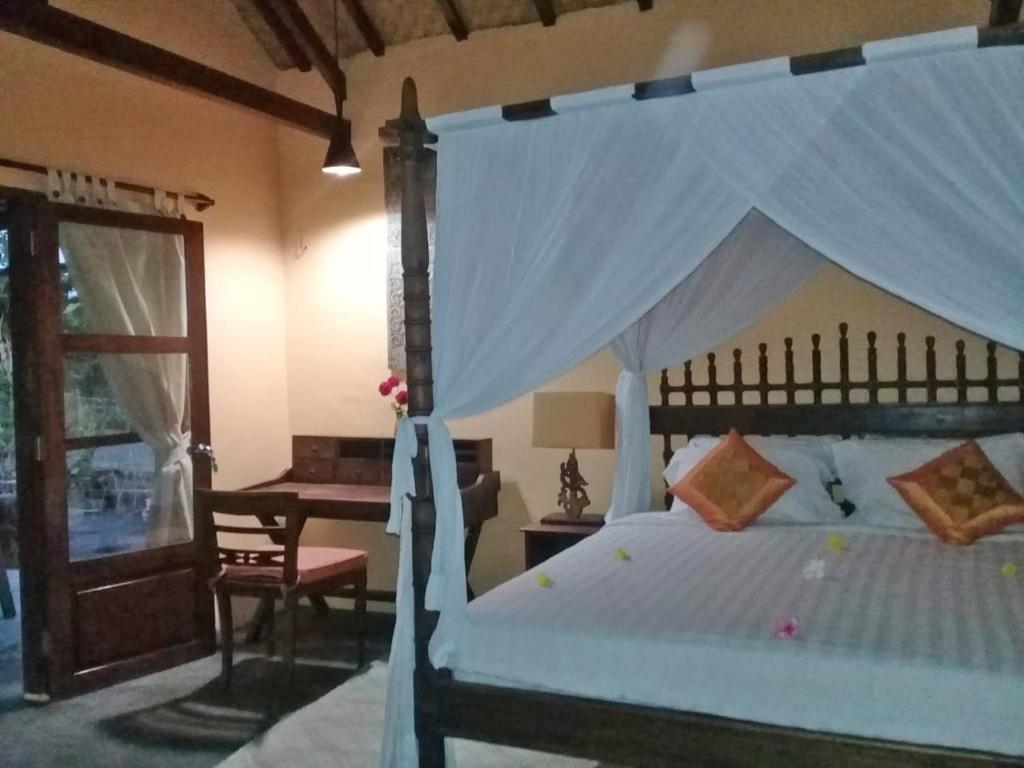 A bed or beds in a room at Waiara Village Guesthouse