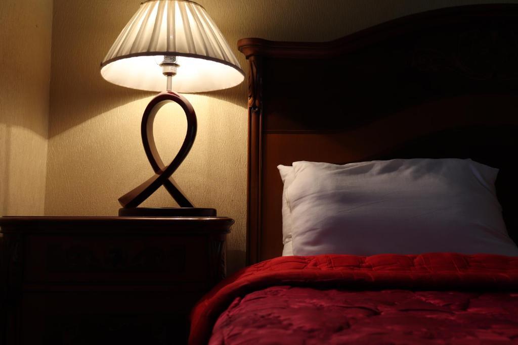 Cama ou camas em um quarto em Between 28may Metro station and National Boulevard Seaside Park