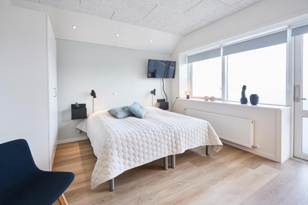 En eller flere senge i et værelse på athome apartments