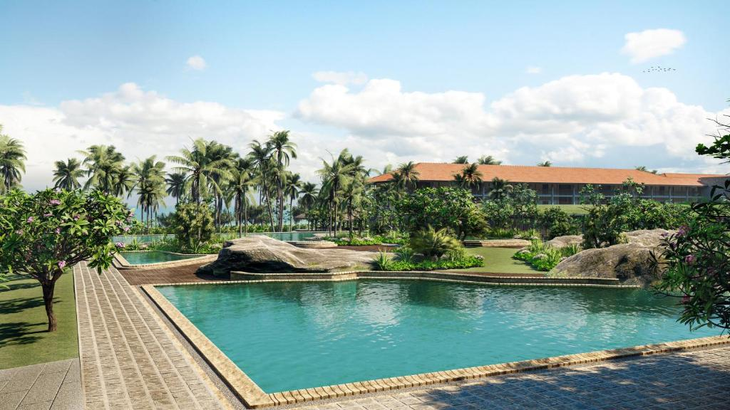 The swimming pool at or near Cinnamon Bentota Beach