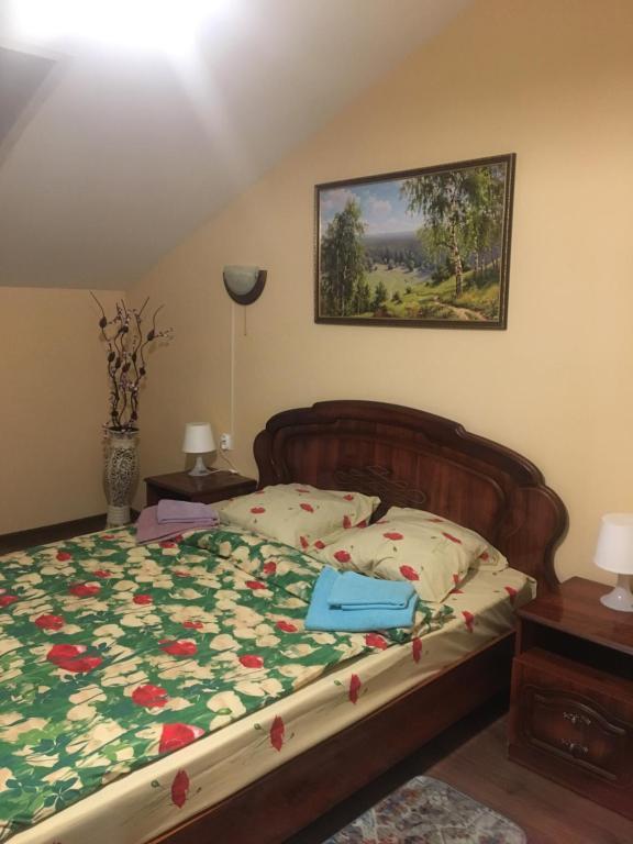 Кровать или кровати в номере Хостел Фавор