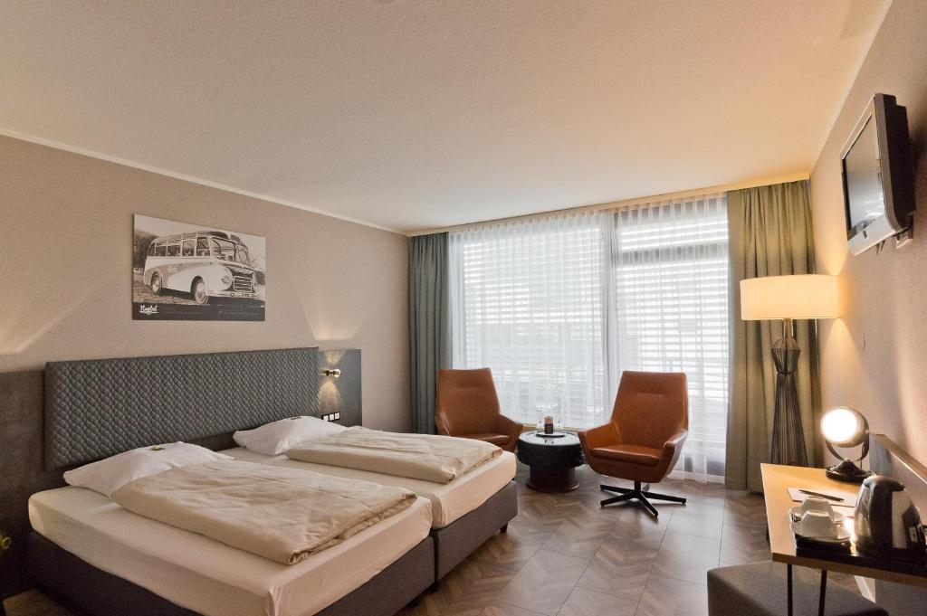 A bed or beds in a room at Arthotel ANA Neotel