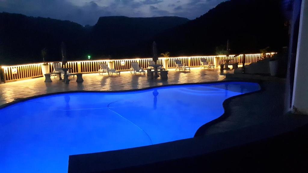 The swimming pool at or close to Umtamvuna View Cabanas